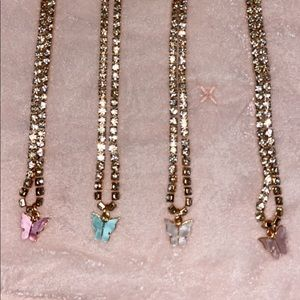 4 necklaces with butterflies